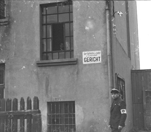 http://www.holocaustresearchproject.org/ghettos/judenratgal/A%20Jewish%20policeman%20stands%20guard%20outside%20the%20ghetto%20courthouse.jpg