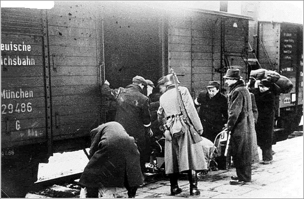 A german soldier looks on as Jews are forced to board the deportation train from Krakow
