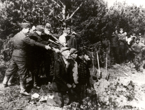 German soldiers shooting Jews outside the Kovno ghetto